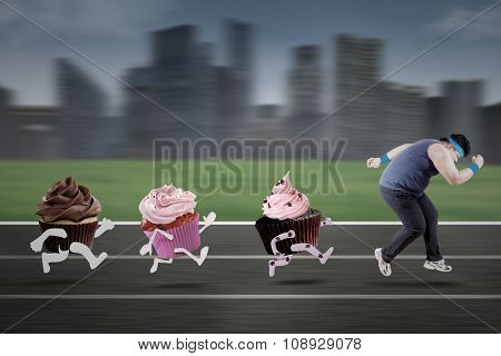 Man Escaping From Cupcakes