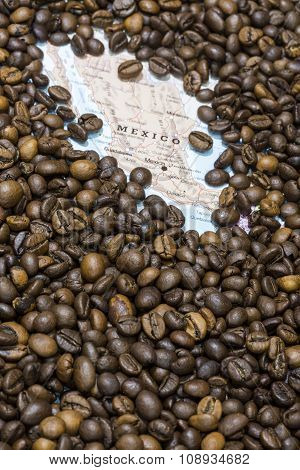 Map Of Mexico Under A Background Of Coffee Beans