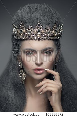Portrait Of A Beautiful Woman In The Diamond Crown And Earrings