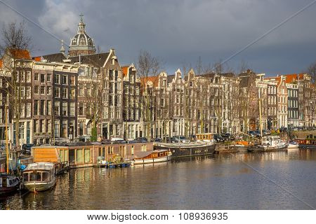 Canal Houses And House Boats In Amsterdam