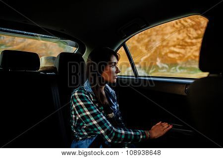 Woman Travel And Dreaming By Car In Mountains