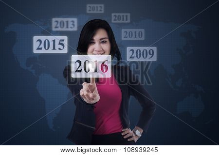 Woman Touching Number 2016 On The Virtual Screen