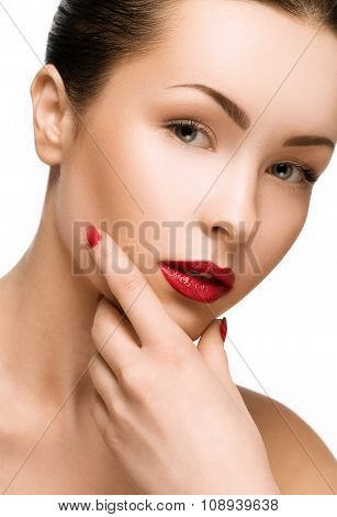 Beautiful Young Model With Red Lips And Red Manicure On White Background.