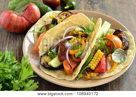 Vegetarian tortilla tacos with grilled vegetables and corn