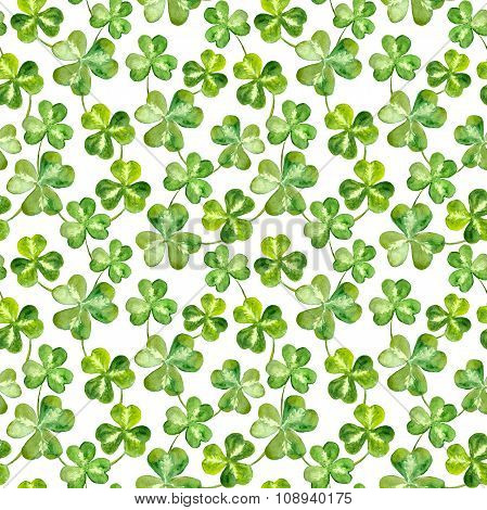 Seamless watercolor background with trefoil clover leaves for Patrick day