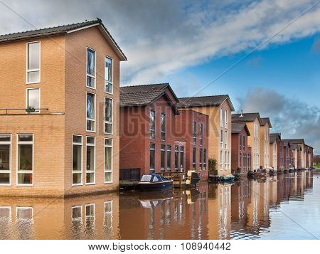 Modern Middle Class Houses Along A Canal