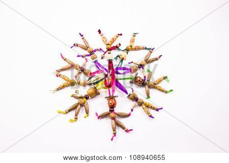 Ten doll made of wooden beads on a colored ribbon