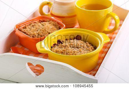 Mini Crumble Cakes In Ceramic Baking Tins