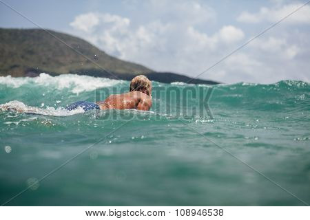 Man Swim Surf In The Sea Back View With Blue Sky