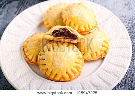 Bite Size Round Pastries On Plate