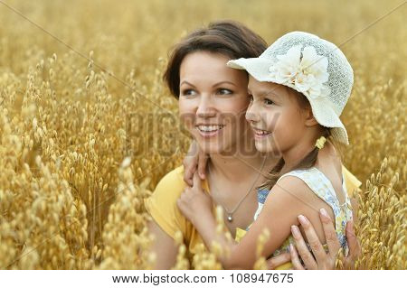 Mother and daughter at  wheat field