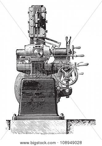 Machine slotting hubs, Front view, vintage engraved illustration. Industrial encyclopedia E.-O. Lami - 1875.