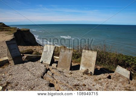 Ancient Headstones At Edge Of Cliff With Erosion Cracks