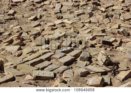 Closeup On Disorder Clay Building Brick Tiles In Sand