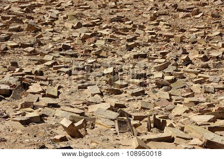 Background Of Clay Building Brick Tiles On Sand