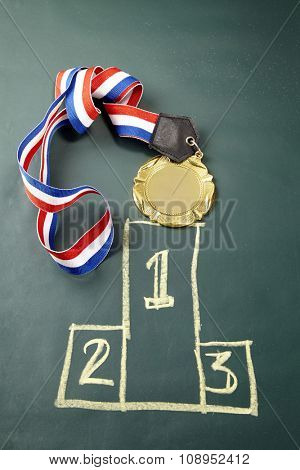 medal on the blackboard with podium drawing