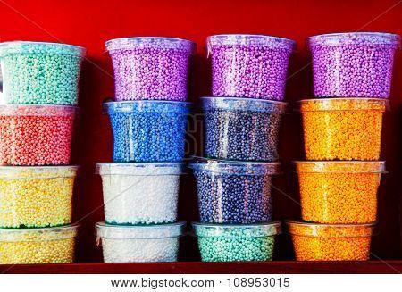 colored plastilina in boxes