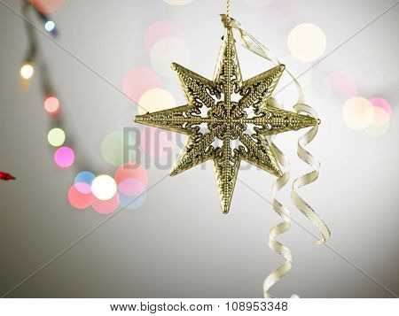 christmas ornament star shape on the bokeh background