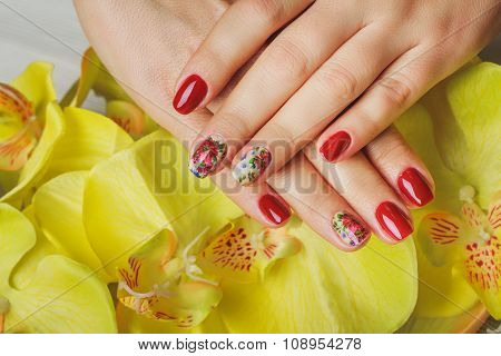 Red nail art with printed flowers