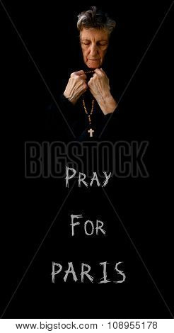 Pray For Paris.an Old  Praying Woman In Black