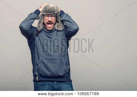 Middle-aged Man Reacting In Shock And Horror