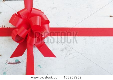 Red Ribbon And Bow On A Vintage Background