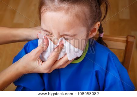 Parent Hand Helping The Girl To Blow Her Nose