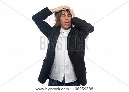 Tired young man touching his head