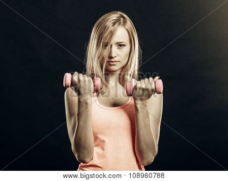 Fitness Girl With Dumbbells Flexing Muscles In Gym