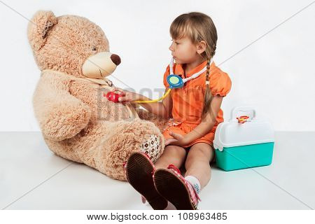 Baby Is Playing Doctor, Treats A Bear