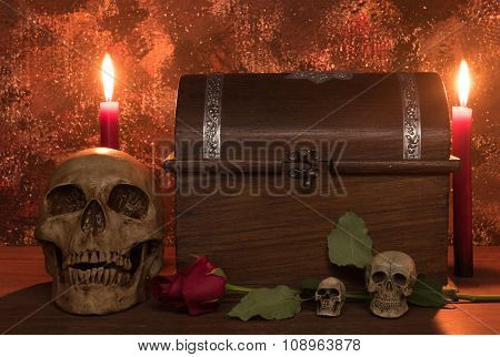 Still Life Painting Photography With Human Skull, Rose, Candle And Treasure Chest On Wooden Table