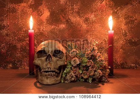 Still Life Painting Photography With Human Skull, Bouquet And Candle On Wooden Table