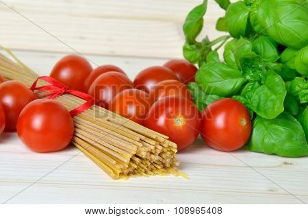 Bunch Of Spaghetti, Cherry Tomatoes And Fresh Basil