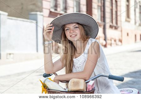Women On Pink Bicycle With Grocery Basket Posing In Street