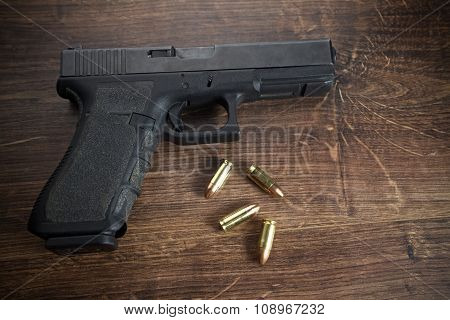 Pistol gun on wooden background