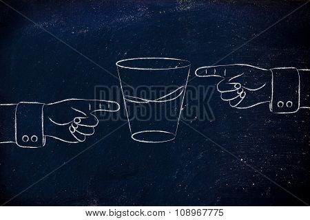 Hands Pointing At Half Full And Half Empty Sides Of Glass Of Water