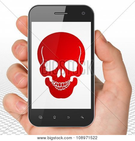 Medicine concept: Hand Holding Smartphone with Scull on display