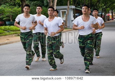 Hanoi, Vietnam - Circa August 2015: Vietnamese Soldiers Run In Training Outside Their  Base