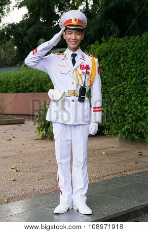 Hanoi, Vietnam - Circa August 2015: Vietnamese Soldier Salutes Outside Ho Chi Minh Mausoleum In  Han