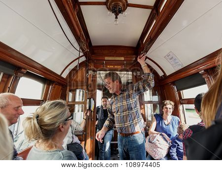 Famous old tram and passengers