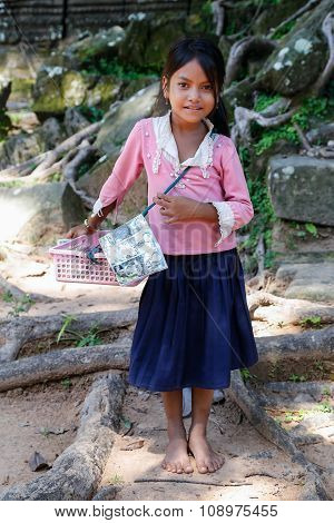 Siem Reap, Angkor Wat/cambodia - Circa August 2015: Young Girl Sells Souvenirs To Tourists Outside O