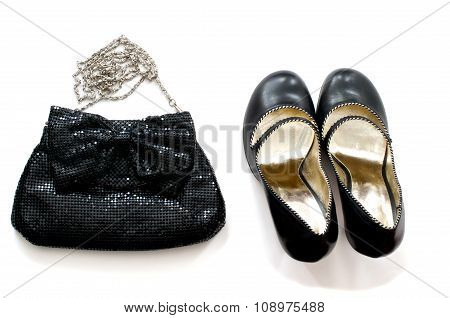 Clutch Bag And Shoes Over White
