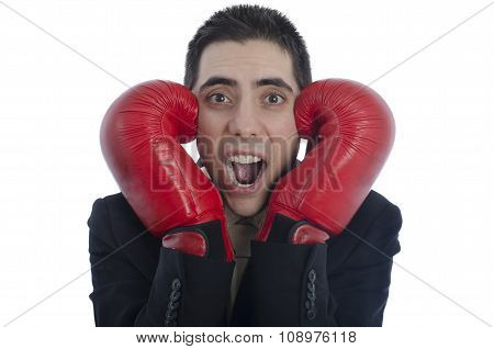 Man In Suit With Red Boxing Gloves With His Hands On Each Side Of His Face Shouting