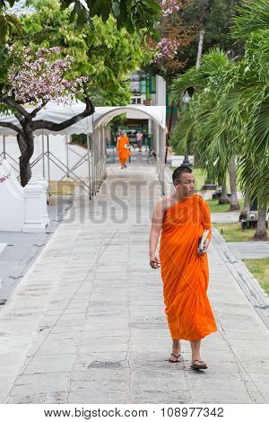Bangkok, Thailand - Circa August 2015: Buddhist Monk Walks Outside The Temple In  Bangkok