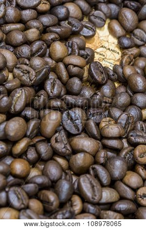 Map Of Uganda Under A Background Of Coffee Beans