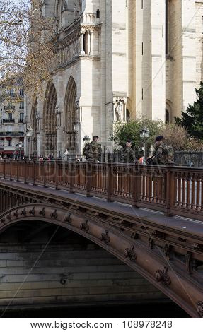 The Military Patrol Near Notre Dame Cathedral.