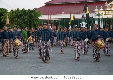 Yogyakarta, Indonesia - Circa September 2015: Ceremonial Sultan Guards In Sarongs March In Front Of