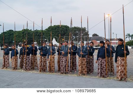Yogyakarta, Indonesia - Circa September 2015: Ceremonial Sultan Guards In Sarongs Standing With Spea