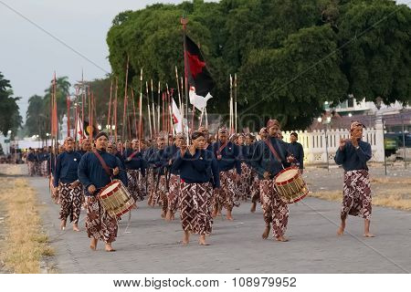 Yogyakarta, Indonesia - Circa September 2015: Ceremonial Sultan Guards In Sarongs March In Formation