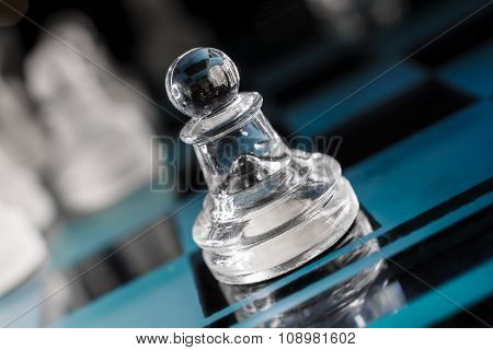Transparent Pawn On Blue Chessboard With Crooked Angle